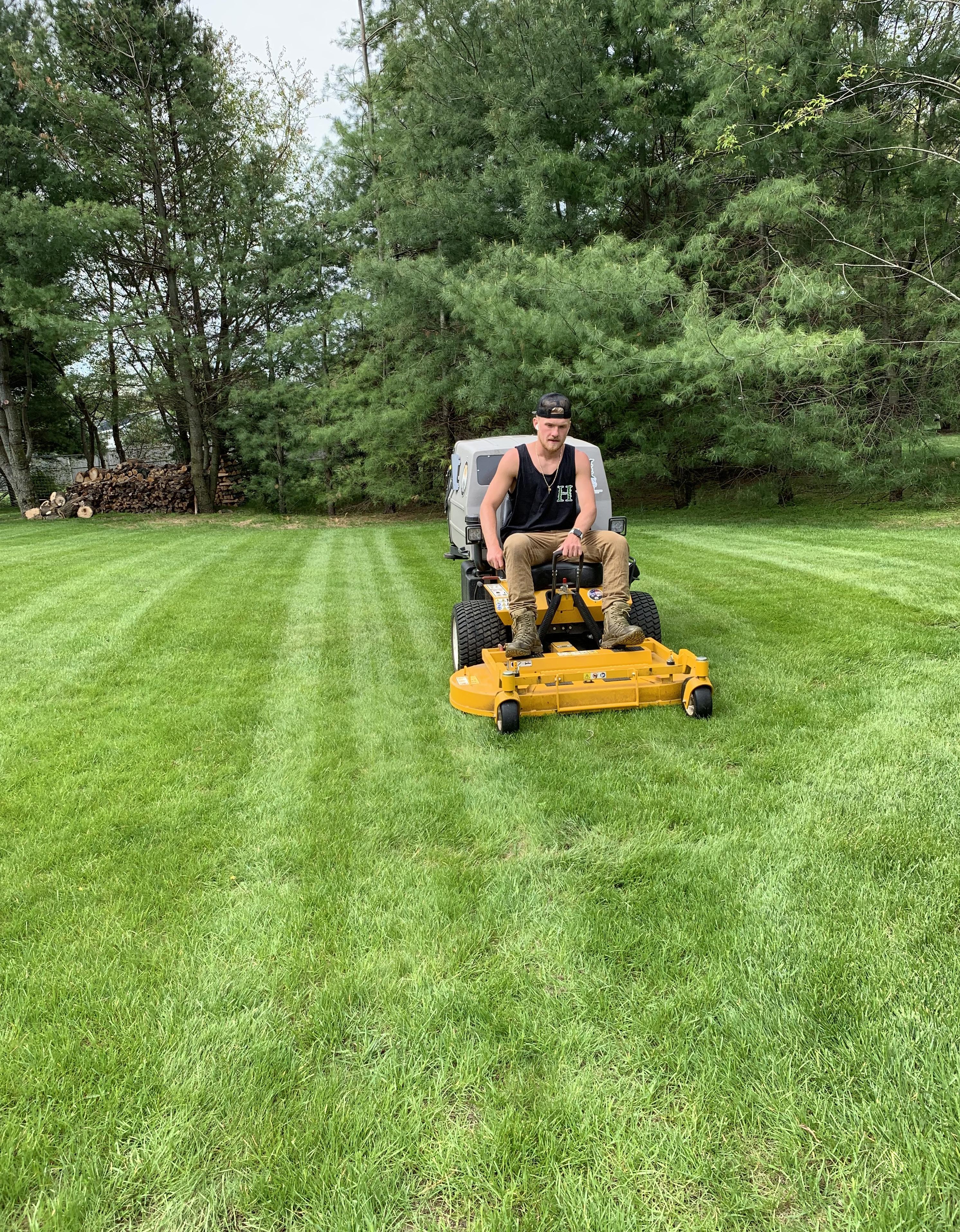 Jack Haraden mowing lawns