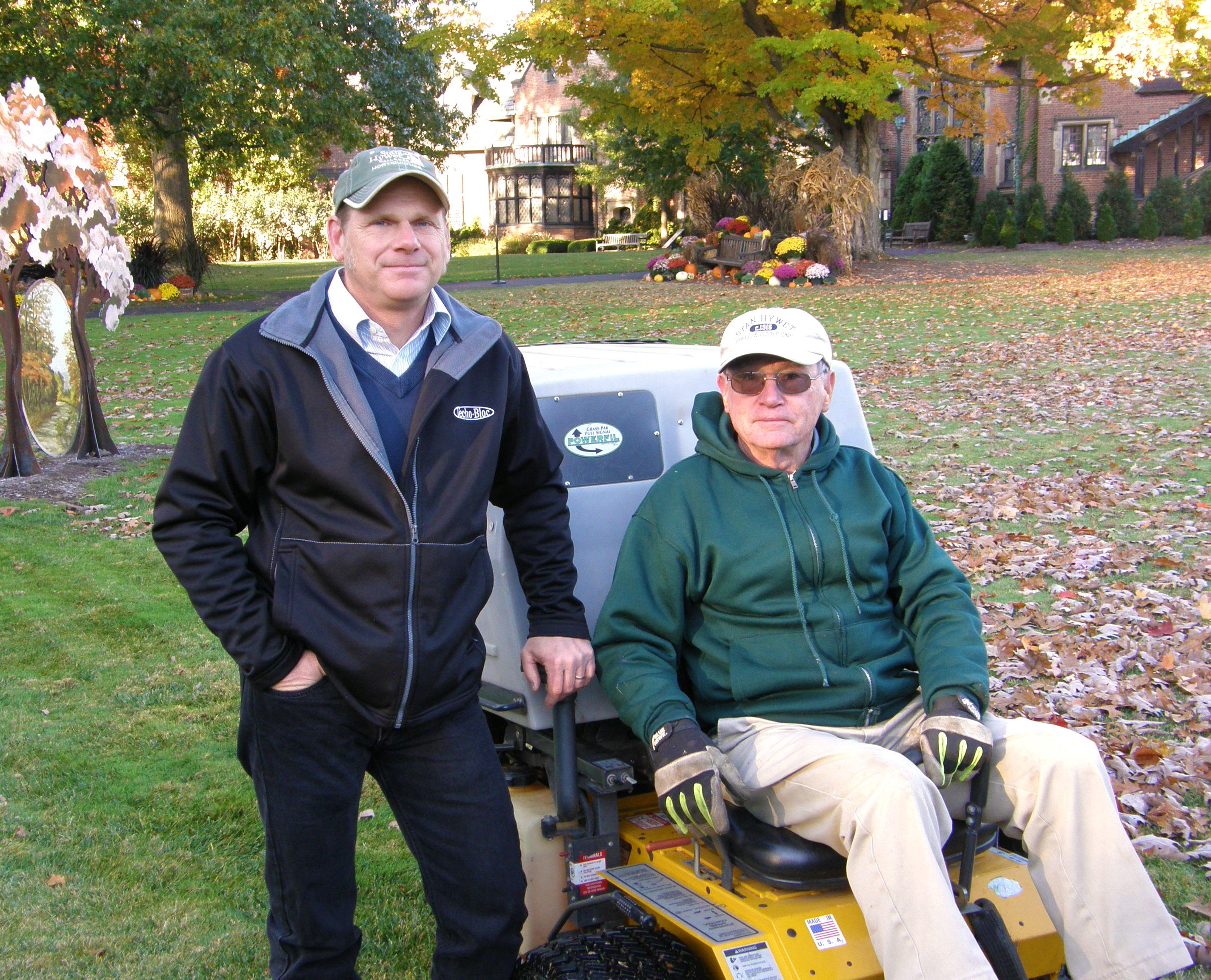 Tom Hrivnak and a volunteer with the Walker Mower